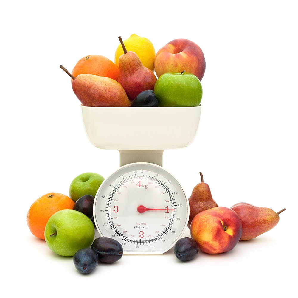 Various fruit on a scale